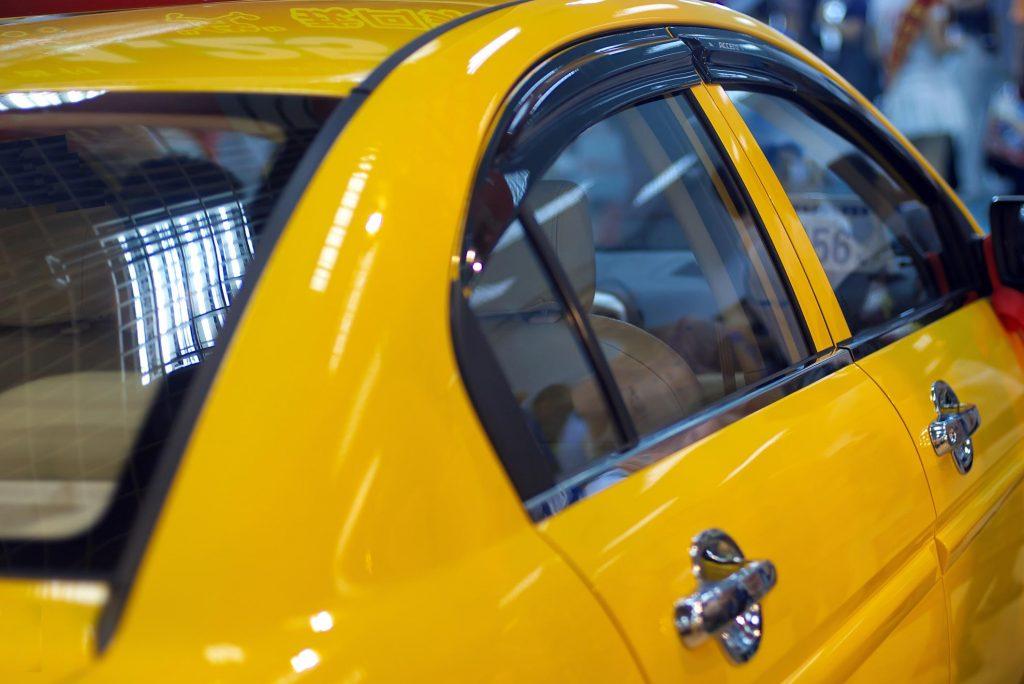 a shiny yellow car