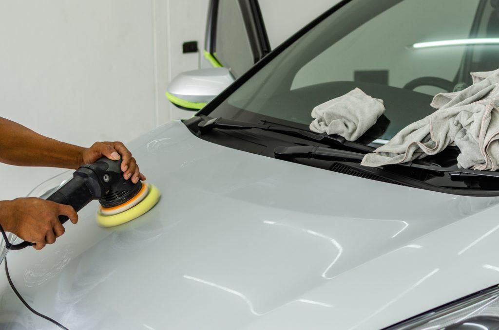 someone polishing the car